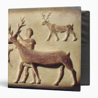 Painted relief depicting a man with deer 3 ring binder