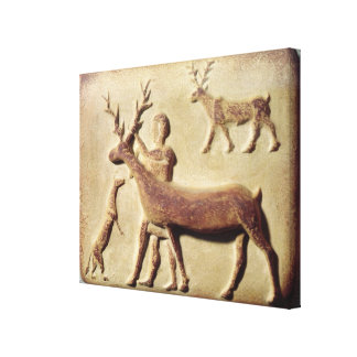 Painted relief depicting a man with deer canvas print