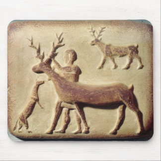 Painted relief depicting a man with deer mouse pad