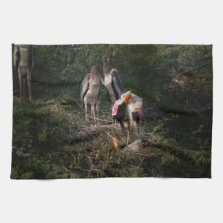Painted storks in a nest kitchen towel
