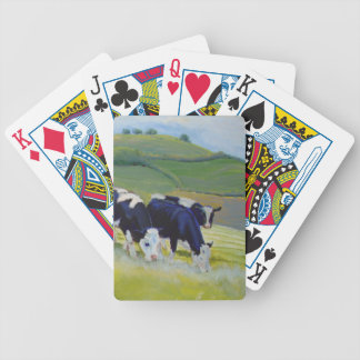 Painting of black and white holstein friesian cows bicycle playing cards