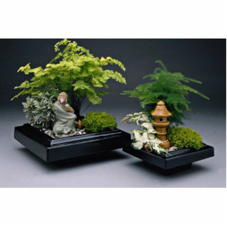 Pair of bonsai trees with ornamental figures statuette