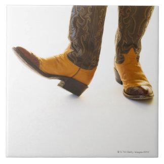 Pair of cowboy shoes large square tile