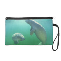 Pair of florida manatees swimming wristlet purse