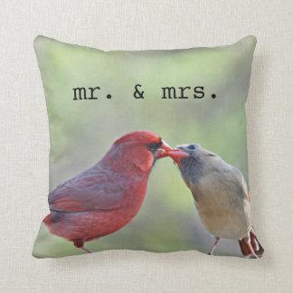 Pair of northern cardinals throw pillows