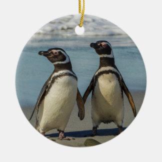 Pair of penguins on the beach ceramic ornament