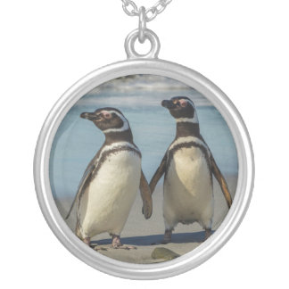 Pair of penguins on the beach silver plated necklace