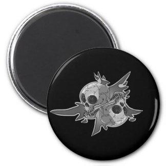 pair of skull cartoon magnet