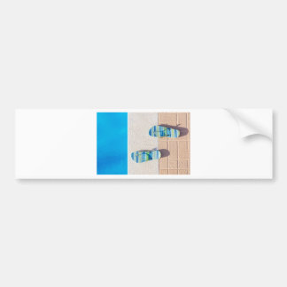 Pair of slippers at edge of swimming pool bumper sticker