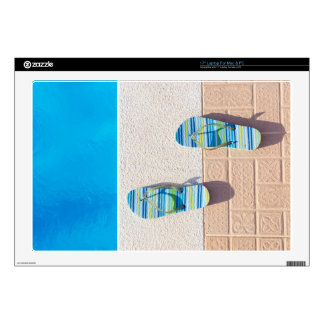 Pair of slippers at edge of swimming pool decal for laptop
