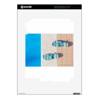 Pair of slippers at edge of swimming pool decals for iPad 2