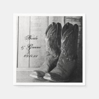 País rústico de las botas de vaquero que casa las servilletas de papel