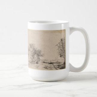 Paisaje con los árboles, los edificios agrícolas y taza de café