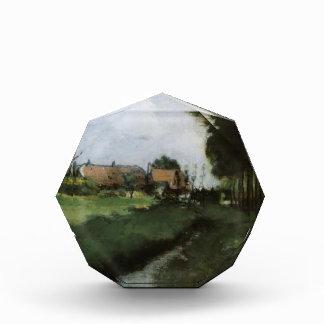 Paisaje de Juan Twachtman- con las casas y la corr