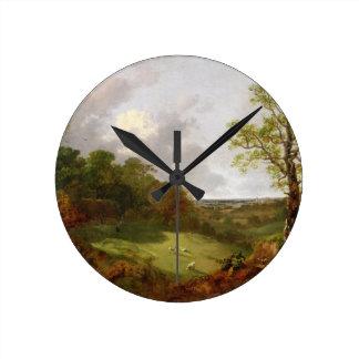 Paisaje enselvado con una cabaña, ovejas y un Recl Reloj Redondo Mediano