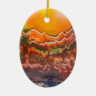 Paisaje estriado adorno navideño ovalado de cerámica