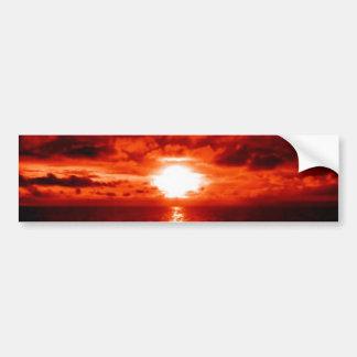 Paisaje marino rojo de la puesta del sol pegatina para auto
