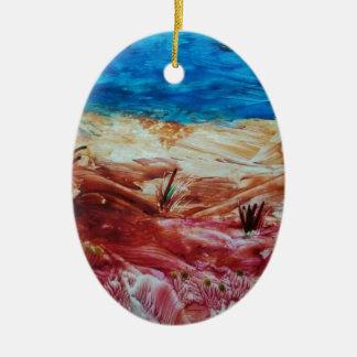 Paisaje rojo y marrón adorno navideño ovalado de cerámica
