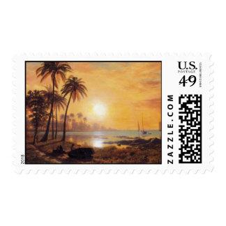 Paisaje tropical con los barcos de pesca por timbre postal