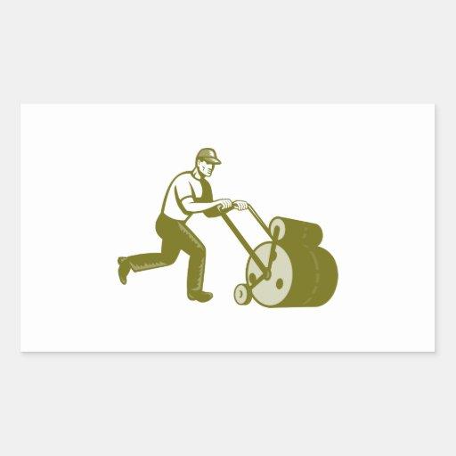 Paisajista del jardinero que empuja el rodillo del rectangular pegatinas