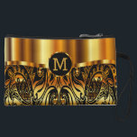 """Paisley Gold and Black Monogram Design Wristlet<br><div class=""""desc"""">Paisley Gold and Black Monogram Design. 100% Customizable. Ready to Fill in the box(es) or Click on the CUSTOMIZE button to add, move, delete, resize or change any of the font or graphics. Made with high resolution vector and/or digital graphics for a professional print. NOTE: (THIS IS A PRINT. All...</div>"""