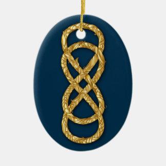 Paja doble tejida del oro del infinito en azul pro ornamento de reyes magos