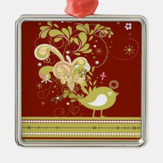 Pájaro abstracto del oro en el ornamento de adorno cuadrado plateado
