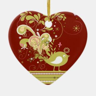 Pájaro abstracto del oro en el ornamento del adorno de cerámica en forma de corazón