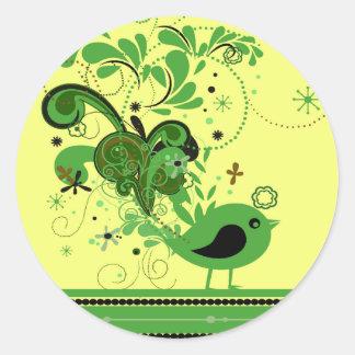 Pájaro abstracto verde en los pegatinas redondos pegatina redonda