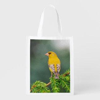 Pájaro amarillo en rama bolsas reutilizables