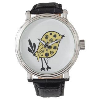 Pájaro amarillo y negro en un reloj negro