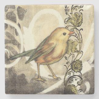 Pájaro amarillo y verde en fondo del vintage posavasos de piedra