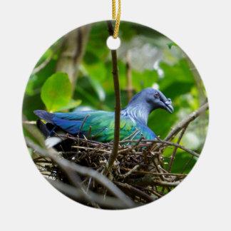 Pájaro azul adorno navideño redondo de cerámica