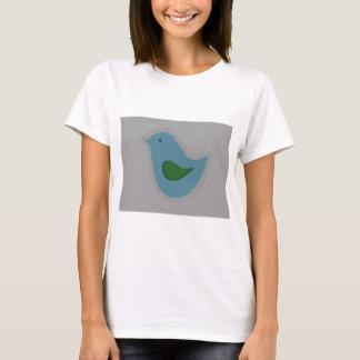 pájaro azul con el ala verde playera