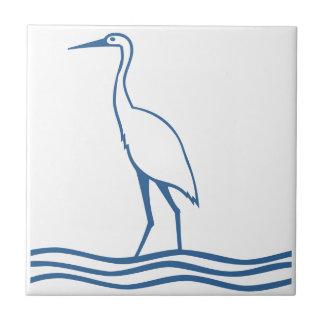 Pájaro azul de la agua de mar de la garza de azulejo cuadrado pequeño