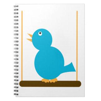 Pájaro azul en un cuaderno de la perca
