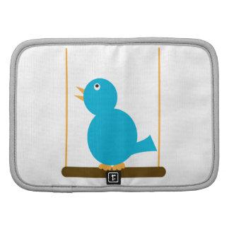 Pájaro azul en un folio del carrito de la perca planificador