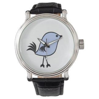 Pájaro azul en un reloj negro