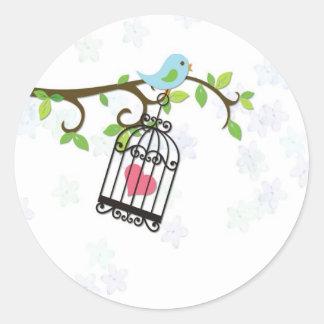 Pájaro azul jaula de pájaros pegatina
