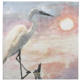 Pájaro blanco en la puesta del sol de la playa servilleta de papel