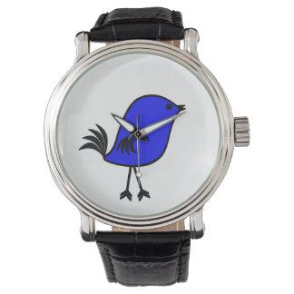 Pájaro brillante, azul en un reloj negro