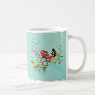 Pájaro cantante rojo del ~ del pájaro que se sient taza