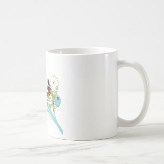 Pájaro cantante rojo del ~ del pájaro que se sient taza de café