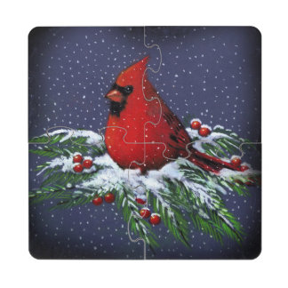 Pájaro cardinal del navidad en ramas del pino con  posavasos de puzzle