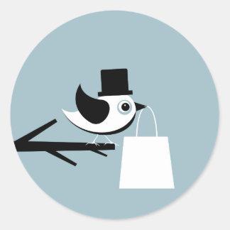 Pájaro con un paquete pegatina redonda