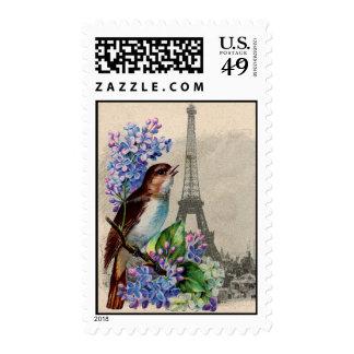Pájaro de la postal de París en sello de las lilas