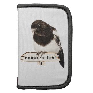 Pájaro de la urraca de la diversión con nombre o e planificador