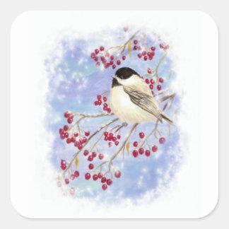 Pájaro del invierno a través de la ventana Nevado. Pegatina Cuadrada