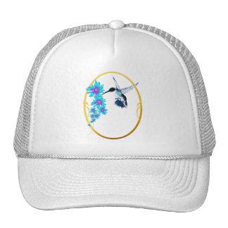 Pájaro del tarareo en gorra azul