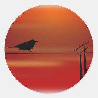 Pájaro en el alambre de A Pegatina Redonda